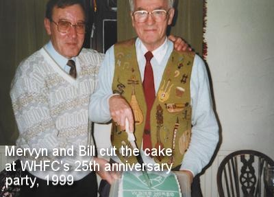 Mervyn and Bill cut the cake at WHFC's 25th Anniversary party, 1999